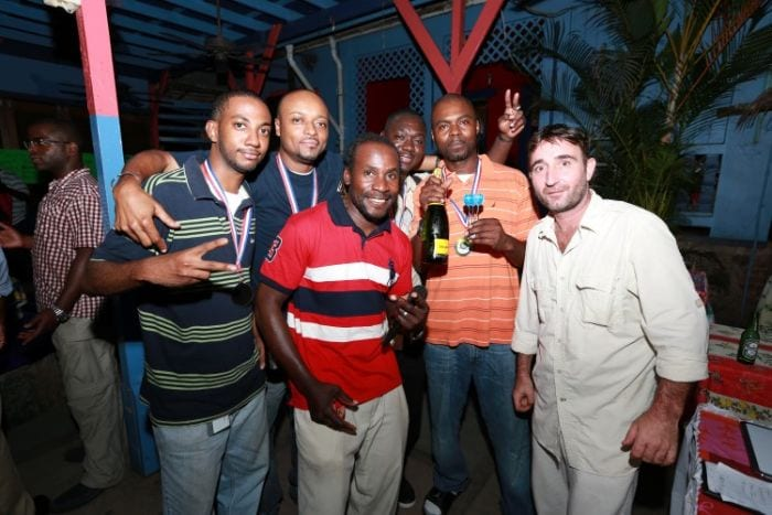 Elwin Lee (Centre front) with Dream Team, one of many groups who participate in BVI darts tournaments
